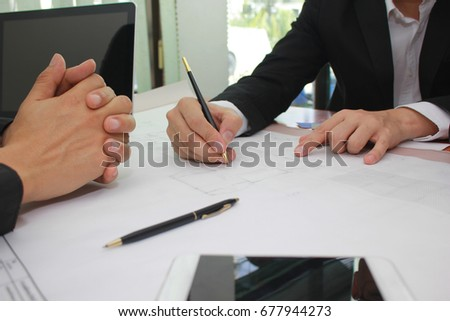 Hands of engineer working on blueprint at office, Business corporate people working concept #677944273