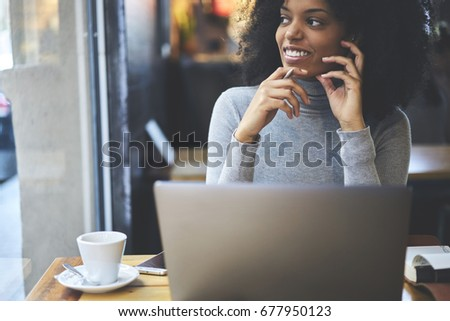 Cropped image of pondering smiling businesswoman looking away while thinking about successful ideas for personal startup project.Thoughtful positive hipster girl resting in coffee shop with gadgets #677950123