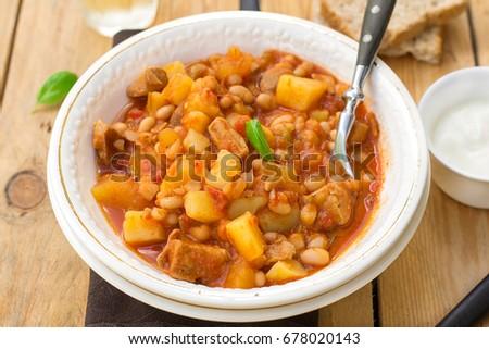 Potato stew with pork and white kidney beans in tomato gravy #678020143