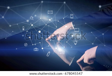 Male hands touching interactive table with blue mixed communication icons in the background #678045547