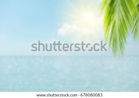 Blur the beautiful natural palm leaves on a tropical beach with bokeh background lighting, abstract light backgrounds. Copy space of summer vacation and business travel ideas. #678080083