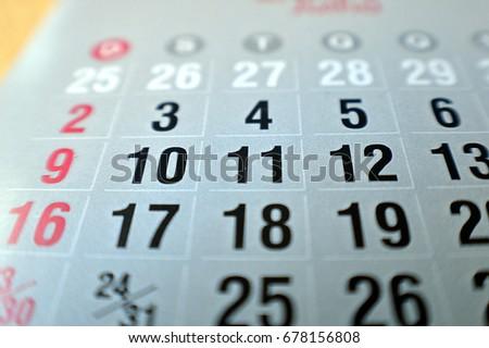 Calendar macro shot, focusing on the numbers ten and eleven #678156808
