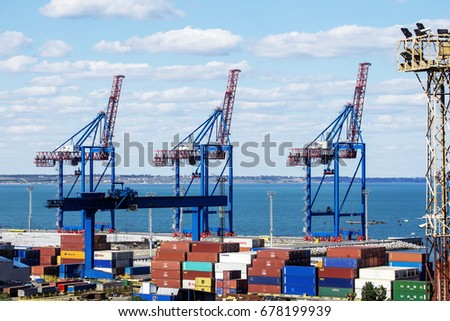 ODESSA, UKRAINE - July 14, 2017: Marine Industrial Commercial Port. Container terminal. Cargo container terminal of sea freight industrial port. Sea freight, container cranes. Industrial goods in port #678199939