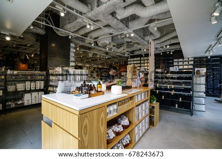KOBE, JAPAN - JULY 16, 2017: Goods inside Muji Store. MUJI is popular Japanese brand which sell home and decor items as well as clothing and accesories. #678243673