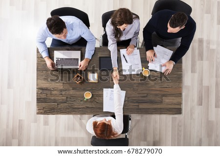 Group Of Corporate Recruitment Officers Shaking Hand With Candidate Arrived For Interview Royalty-Free Stock Photo #678279070