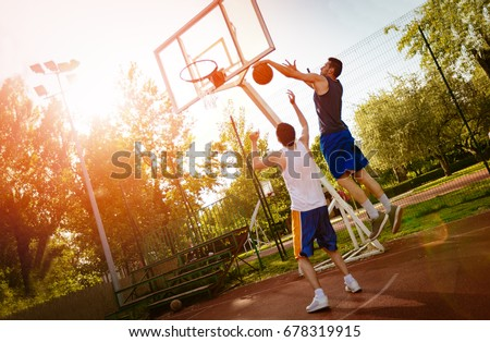 Two street basketball players having training outdoor. They are making a good action. #678319915