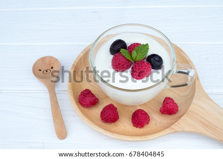 Fruit yogurt On a white wood table #678404845