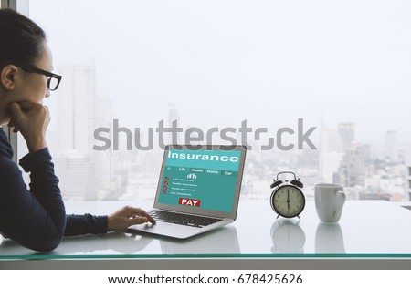 Insurance concept. Women use laptops to search for insurance online on a home office. #678425626