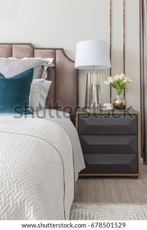classic bedroom style with set of pillows and lamp on table side, interior design concept #678501529