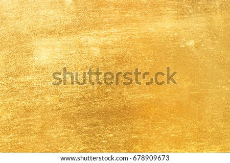 Shiny yellow leaf gold foil texture background #678909673