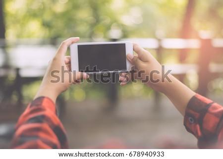 Closeup of woman hands using smartphone #678940933