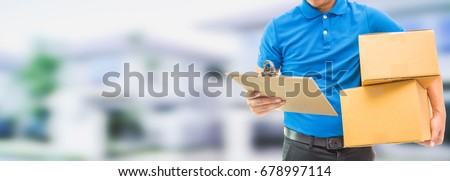 Delivery man holding cardboard boxes / copy space #678997114