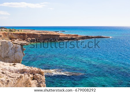 Rock cliffs and sea bay with azure water near Protaras, Cyprus island. #679008292