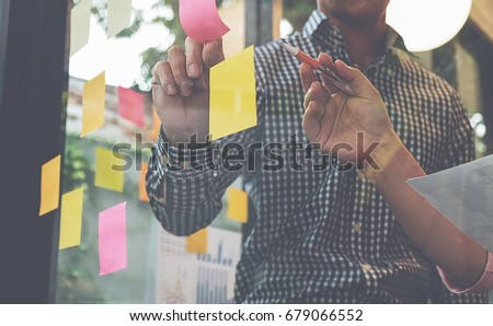 Start up partners are working in casual clothes, discussing the ideas for new strategy of development. Royalty-Free Stock Photo #679066552