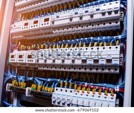 Voltage switchboard with circuit breakers. Electrical background Royalty-Free Stock Photo #679069102