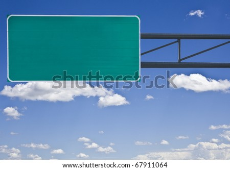 Empty highway sign isolated on cloudy sky