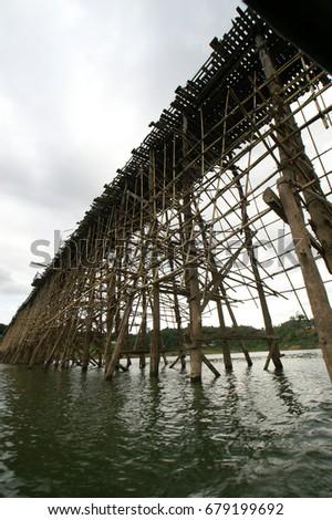 The beautiful wooden bridge at Sangklaburi in Kanchanaburi, Thailand #679199692