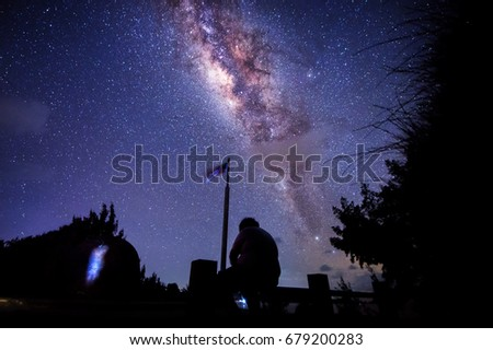 Starry night with Milky Way at Kudat Malaysia. Image contain soft focus and blur due to long expose and wide aperture. Image also contain noise and grains due to high ISO.  #679200283