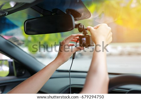 Hands installation front camera car recorder, Car DVR Vehicle. Royalty-Free Stock Photo #679294750