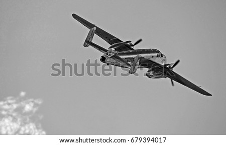 "U.S. Air Force North America B-25 ""Mitchell"" bomber aircraft in the sky black and white #679394017"