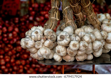 garlic for sell on market, famous natural local products in Si Sa Ket province, Thailand #679417924