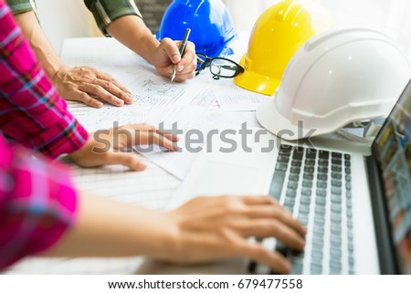 Engineer working on construction project,helmet and laptop on the table. #679477558