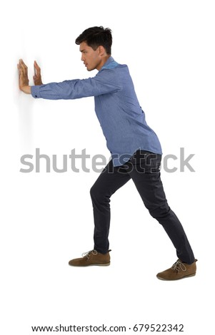 Side view of businessman pushing something against white background #679522342