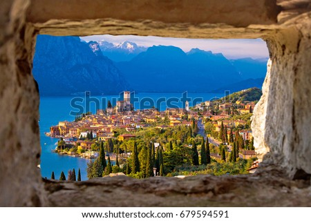 Malcesine and Lago di Garda aerial view through stone window, Veneto region of Italy #679594591