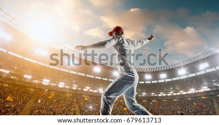 Cricket bowler in action on a professional stadium. The player wears unbranded clothes. The stadium is made in 3D. #679613713