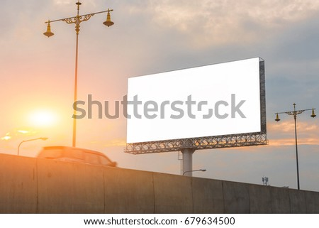White blank billboard and sunlight of sunset - can advertisement for display or montage product and business #679634500