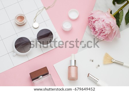 Beauty flat lay with cosmetic bottles, phone and flower. Top view #679649452