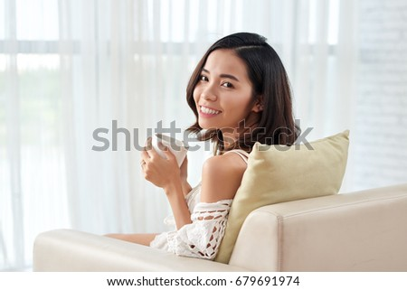 Portrait of beautiful Vietnamese young woman with a cup of tea #679691974