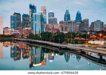 Philadelphia skyline at night with the Schuylkill river