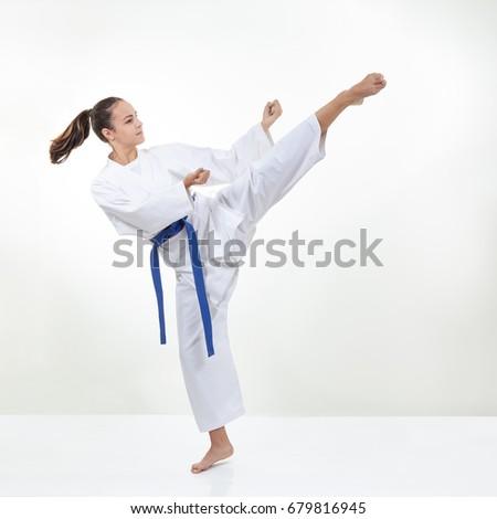 On a light background, the athlete kicks #679816945