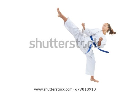 A high circular kick is struck by an athlete with a blue belt Royalty-Free Stock Photo #679818913
