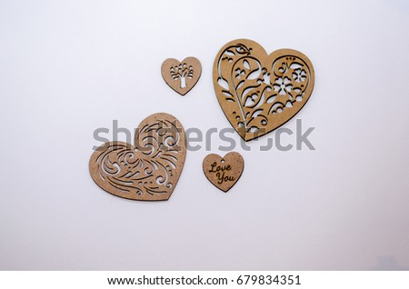 Four  wooden hearts on a white background #679834351