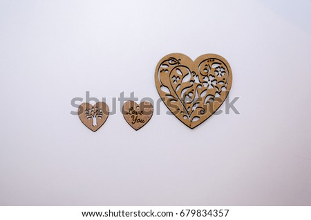 Three wooden hearts on a white background #679834357