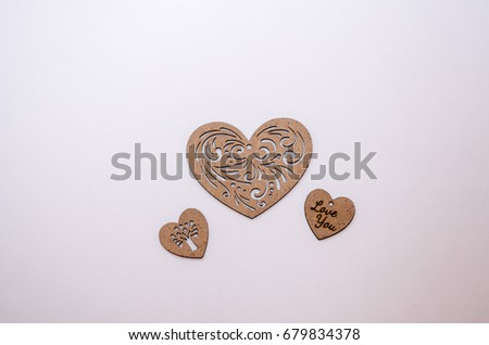 big heart between two little hearts on a white background #679834378