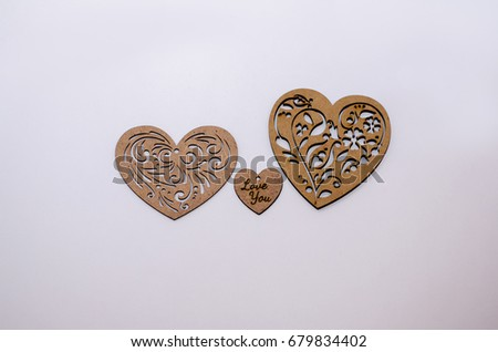 Three wooden hearts on a white background #679834402