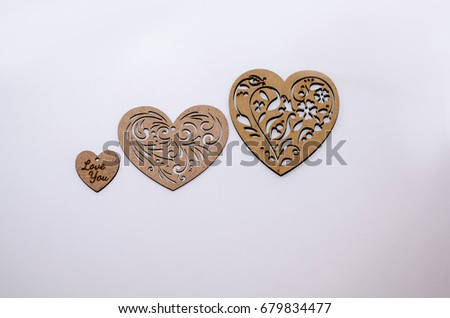 Three wooden hearts on a white background #679834477
