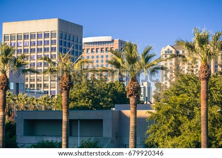 Office buildings and palm trees in downtown San Jose at sunset, California