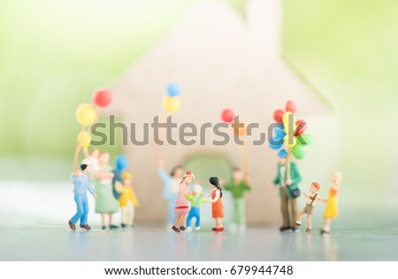 Miniature people : Group of family with balloon using as background family day concept. #679944748