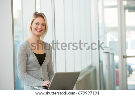 Young female professional working on computer #679997191