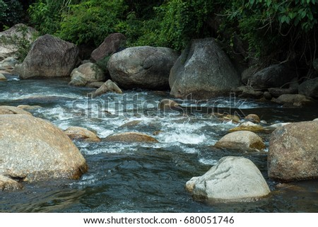 running of water stream from waterfall in tropical rain forest #680051746