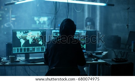 Team of Internationally Wanted Teenage Hackers Infect Servers and Infrastructure with Ransomware. Their Hideout is Dark, Neon Lit and Has Multiple displays. #680074975