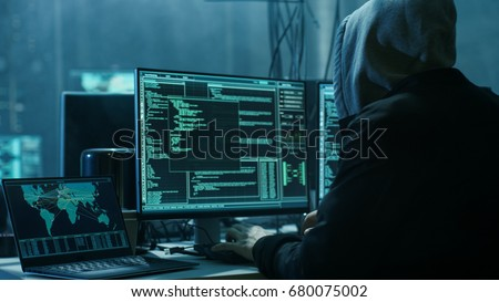 Dangerous Hooded Hacker Breaks into Government Data Servers and Infects Their System with a Virus. His Hideout Place has Dark Atmosphere, Multiple Displays, Cables Everywhere. #680075002