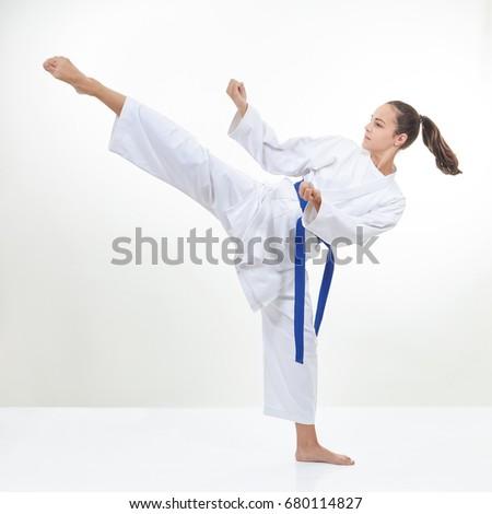 Sportswoman is training kick #680114827