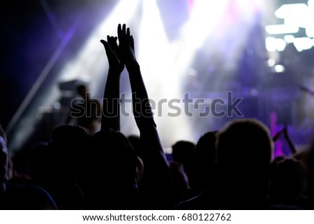 crowd with raised hands at concert - summer music festival #680122762