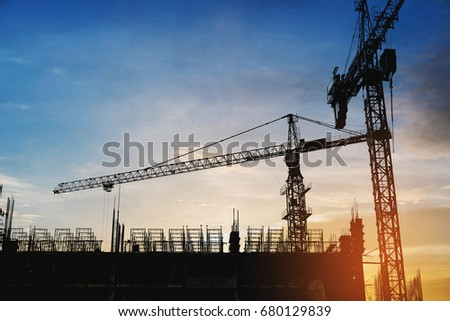 Silhouette building construction site with cranes in sunset #680129839