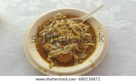 "Char kway teow, literally ""stir-fried ricecake strips"", is a popular noodle dish in Malaysia, Singapore, Brunei and Indonesia. The dish is considered a national favourite in Malaysia and Singapore; #680136871"